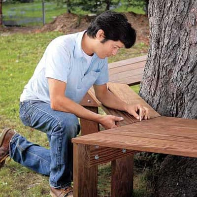 10 outdoor diy projects that inspire beauty and relaxation for Benches that go around trees