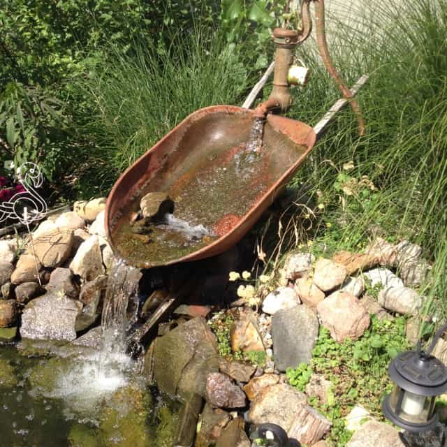 Old fashioned water pump fountains 50