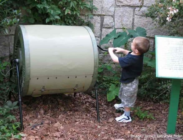 Young Boy Turning And Demonstrating Compost Tumblers